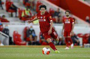 Takumi Minamino of Liverpool in action during the Premier League match between Liverpool FC and Crystal Palace at Anfield Wednesday.POOL/2020 POOL Liverpool is on the verge of ending its 30-year English Premier League soccer title drou